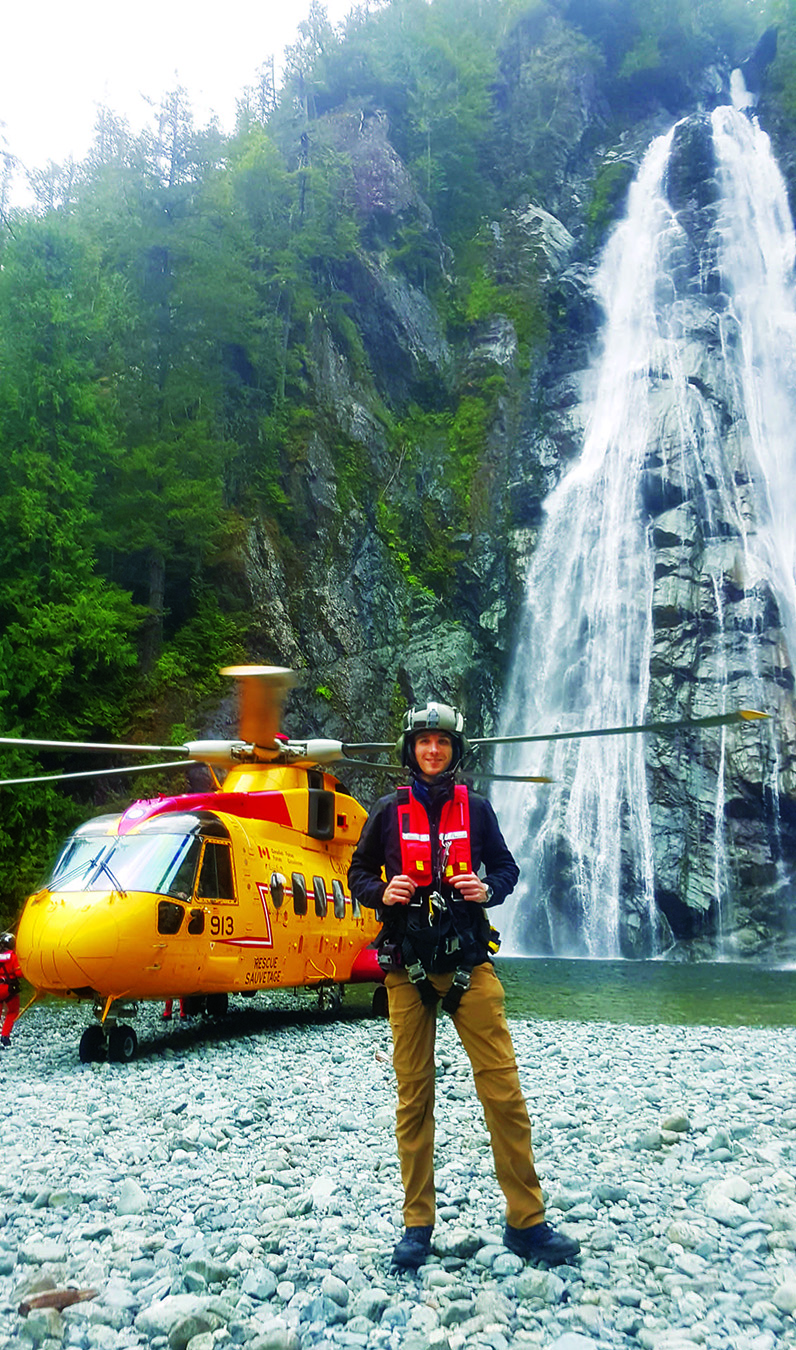 Dr Obert in front of the CH-149 Cormorant after a challenging confined space landing at the foot of a waterfall on Vancouver Island.