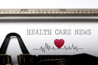 "A sheet of paper on a typewriter that reads ""Health Care News"""