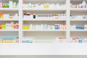 Shelves in a pharmacy with an assortment of medications