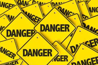 Many overlapping danger signs