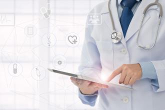 A doctor uses a tablet; to the side is a line drawing of a network with several different medical icons