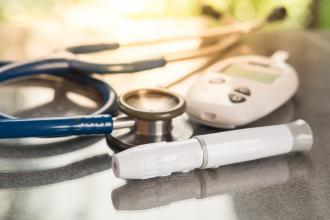 A stethoscope, a blood glucose meter, and an insulin injector