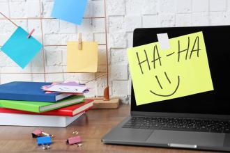 "A computer with a Post-it note that says ""haha"""