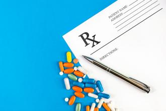 A prescription slip and a variety of medications