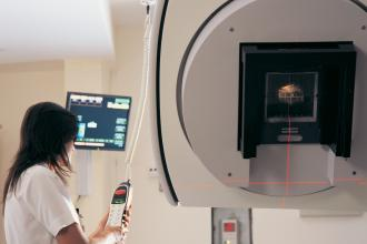 A technician uses a linear accelerator