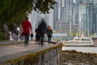 People walking on the Stanley Park Seawall, Vancouver