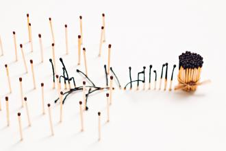 The concept of social distancing using matchsticks; some are in a bundle, while others are spread out