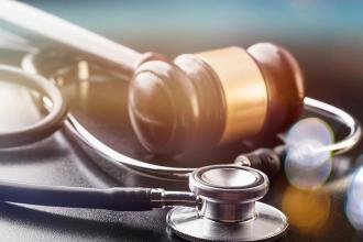Judge gavel and stethoscope in close-up
