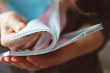 A woman reads a magazine