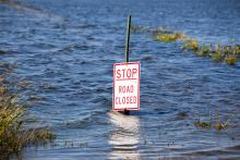 Road Closed sign on flooded road