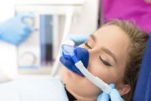 Young woman being sedated through inhalation sedation