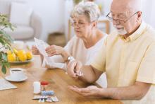 Senior man taking medicament