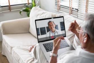 A patient consults with their doctor by videoconference
