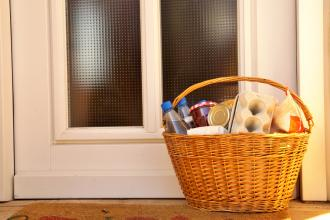 A basket of groceries on a doorstep