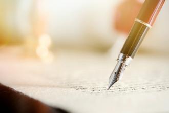 A closeup of a pen and paper
