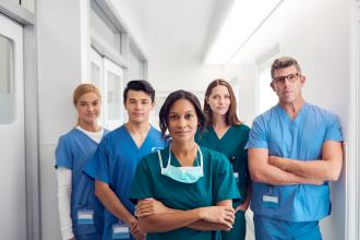 A group of doctors stands in a hospital corridor