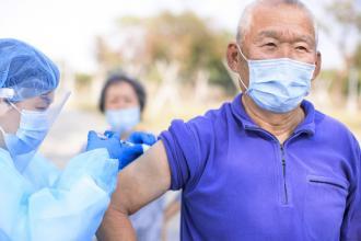 A senior receives a vaccination