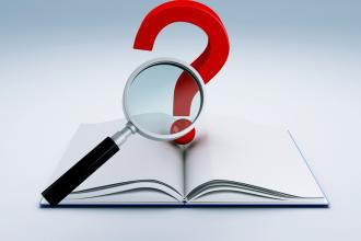 A book with a question mark and a magnifying glass