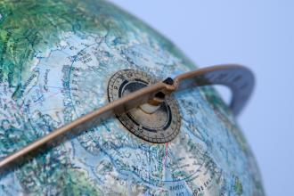 A tilted globe zoomed in on the North Pole