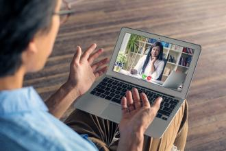 Man video calling his physician to have a virtual session