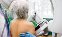 Woman having a mammography scan at a hospital