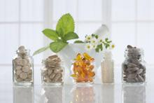 Different types of vitamins in glass jars