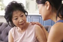 A woman cares for her mother, who has dementia