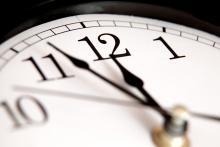 A clock approaches midnight