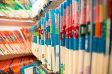 A close up of medical records on shelves.