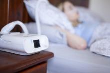 A woman uses a CPAP machine