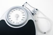 A stethoscope sits by a scale
