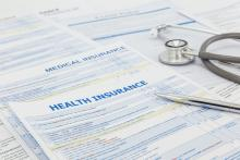 Health insurance forms sit on a table