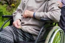 A senior sits in a wheelchair