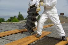 Crew removing asbestos roofing