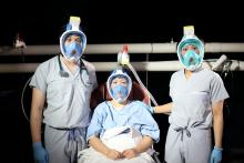 L-R: Mr Justin Chan, Ms Louise Chen, and Ms Kate Koh. The snorkel mask can be used as an alternate form of PPE for health care providers and for non-invasive positive pressure ventilation for patients. Photo courtesy of Lydia Nagai Photography.