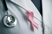 Doctor wearing a pink ribbon