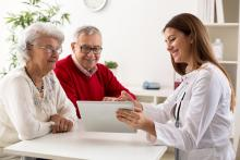 Healthy elderly couple, happy doctors