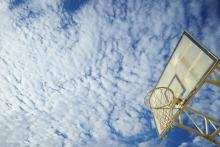 Blue sky with clouds and a basketball backboard