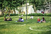 Groups of people physically distancing in a park