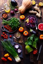 Assortment of fresh raw vegetables on a wooden background