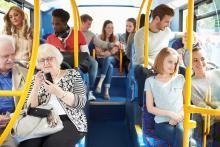 Interior of the bus full of happy bus riders