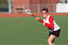 Fierce girl playing lacrosse
