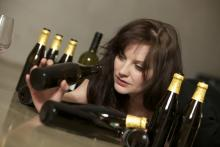 Woman that has finished multiple bottles of alcohol